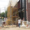 Record-Eagle/Bill O'Brien<br /> <br /> Work moves ahead on a new CVS pharmacy at the corner of West Front and Division streets in Traverse City. Project developers said construction of the 13,500-square foot drug store should be completed within two months, and the store is slated to open by late October.