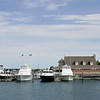 Record-Eagle/Keith King<br /> Officials investigate the scene where 18-year-old Mancelona resident Michael Knudsen drowned while swimming off of Dock F in Clinch marina.