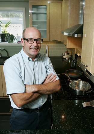 Record-Eagle/Keith King<br /> Robert Egan, of Traverse City, in his kitchen. Egan will be a local adoptee of visiting chef Jennifer McLagan during the Epicurean Classic in Traverse City.