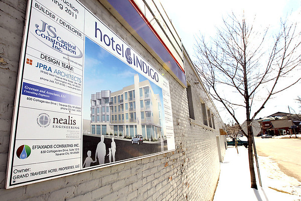 Record-Eagle file photo/Keith King<br /> A sign for Hotel Indigo is displayed on a building in Traverse City's Warehouse District. The building is located on the future site of the proposed hotel.