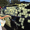 """Record-Eagle/Keith King<br /> Ben Zyber, 15, of Swartz Creek, removes sticky note paper from the truck of Swartz Creek girls golf head coach Deborah Culver at the Grand Traverse Resort & Spa in Acme. Zyber's sister, Haylee Zyber, was competing in the Lober Classic Invitational for the Swartz Creek team while Ben Zyber took the pieces of paper off so that they wouldn't fly away and litter the ground. Culver and her golfers have been playing a variety of pranks on each other using items such as buckets of ice and silly string. """"It was fantastic,"""" Culver said of the prank involving all the paper. """"You want that kind of team that has a good time, has fun and plays well,"""" Culver said. """"So now it's my turn, and I will take my turn,"""" Culver said of the next prank."""