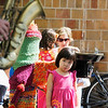 Record-Eagle/Jan-Michael Stump<br /> Josie Song, 3, listens to Dylan Anderson, of Haledon, N.J,. play the saxophone for people on Front Street on Tuesday afternoon.