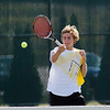 Record-Eagle/Jan-Michael Stump<br /> Traverse City Central's Fisher Sutherland returns a shot in a Tuesday match at West. Fisher won 6-0, 6-0 in Central's 7-1 victory.
