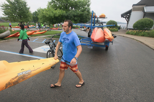 Record-Eagle/Keith King<br /> Troy Daily, co-founder of Create TC, carries a kayak to used for Paddle for Pints, a Traverse City Ale Trail event operated by Create TC, at Hull Park on Boardman Lake.