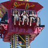 Record-Eagle/Keith King<br /> Matthew Bulovas, from left, 11, his cousin, Madeline Ashley, 11, and his brother, Christopher Bulovas, 13, all of Texas, ride Shock Drop Friday, August 2, 2013 at Arnold Amusements during Harbor Days in Elk Rapids.