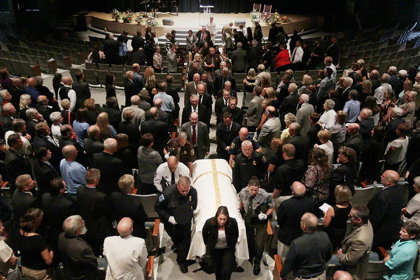 Record-Eagle/Keith King<br /> Pallbearers carry the casket of former Antrim County Prosecutor Charles Koop Friday, August 9, 2013 at the close of his funeral ceremony at New Hope Community Church in Williamsburg.