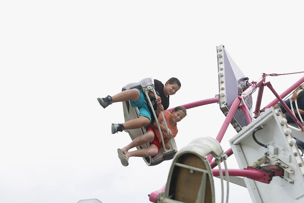 Record-Eagle/Keith King<br /> Alex Bohamed, 11, and his sister Abby Bohamed, 11, ride the Paratrooper ride at the Arnold Amusements Tuesday, August 6, 2013 during the annual Northwestern Michigan Fair in Blair Township.
