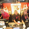 "Record-Eagle/Jan-Michael Stump<br /> Traverse City Film Festival volunteers work the concession stand before the start of Sunday night's film, ""Austenland,"" at the State Theatre."