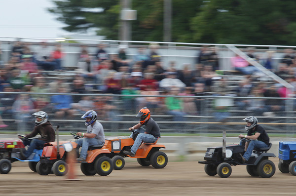 Record-Eagle/Keith King<br /> Lawn mower racers compete Monday, August 5, 2013 during the annual Northwestern Michigan Fair in Blair Township.