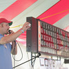 Record-Eagle/Keith King<br /> Pastor Justin Grimm, of Advent Lutheran Church in Lake Ann, calls bingo Tuesday, August 6, 2013 during the annual Northwestern Michigan Fair in Blair Township.