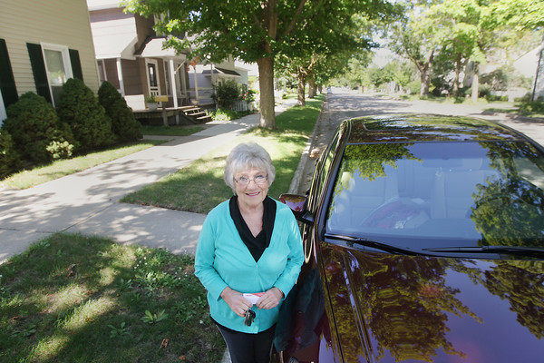 Record-Eagle/Keith King<br /> Michelle Mercer, of Traverse City, stands Thursday, August 8, 2013 next to her car. Mercer completed an AARP Driver Safety Program.