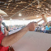 Record-Eagle/Keith King<br /> Ron Bancroft, of Wayne Bancroft Auction Service, calls bids Thursday, August 8, 2013 during the 4-H livestock auction at the Northwestern Michigan Fair.