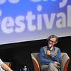 Record-Eagle/Vanessa McCray<br /> <br /> Michael Moore, left, and German film director Wim Wenders, right, chat at the City Opera House during Sunday's Traverse City Film Festival panel.