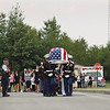 Record-Eagle/Keith King<br /> The body of United States Marine Sgt. Justin Hansen is carried out of the Kingsley High School gymnasium after his funeral service Saturday, August 4, 2012 prior to being taken to Memorial Gardens cemetery in Traverse City.