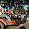 Record-Eagle/Keith King<br /> Kirby Eichstadt, of Cedar, prepares to enter the oval track for a lawn tractor race Tuesday, August 7, 2012 during the Northwestern Michigan Fair.