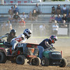 Record-Eagle/Keith King<br /> Lawn tractor racers lean in at a corner as they compete Tuesday, August 7, 2012 during the Northwestern Michigan Fair.
