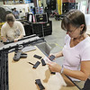 Record-Eagle/Keith King<br /> Ann Bandlow, right, and Ashley McNamara work on interior pieces for the Chevrolet Camaro at Great Lakes Trim in Williamsburg.
