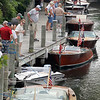 Record-Eagle/Jan-Michael Stump<br /> Spectators enjoy the Boats on the Boardwalk show Saturday on the Boardman River in Traverse City. The annual event, hosted by the Water Wonderland Chapter of the Antique and Classic Boat Society, features antique motorboats lining the river and wooden canoes, sailboats and rowboats on land nearby.