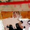 Record-Eagle/Jan-Michael Stump<br /> Danielle Bott, 17, helps decorate the Rickety Ranchers 4-H Club's stalls Saturday.