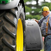 Record-Eagle/Jan-Michael Stump<br /> Martin Woodhams of Voelker Implement Sales, in Lake City, cleans a tractor as they set up for the Northwestern Michigan Fair. Livestock began arriving Saturday, and the fair celebrates Family Day today.