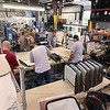 Record-Eagle/Keith King<br /> Employees work at Great Lakes Trim in Williamsburg.