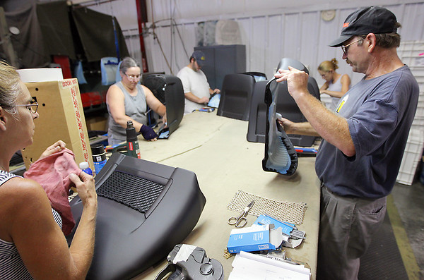 Record-Eagle/Keith King<br /> Cheryl Prentice, from left, Linda Thorpe, Darryl Ingram, Anita Cryderman and Jim Brown work on seatback panels for the Cadillac CTS at Great Lakes Trim in Williamsburg.