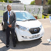 Record-Eagle/Dan Nielsen'<br /> Faiz Ahmad, senior vice president and global business head of engineering for Hinduja Tech Limited, stand near a vehicle the company designed for Nissan that will sell in India for around $4,000.