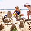 Record-Eagle/Tessa Lighty<br /> Emma Payne, left, and Luna Ready, right, make a sand castle at East Bay Park.
