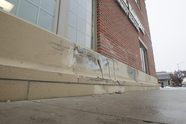 Record-Eagle/Keith King<br /> TRAVERSE CITY -- A vehicle crashed into the newly renovated exterior of the Caldwell Banker building at 402 E. Front St. on Monday. Manager Matt Case said city police looked at the damage Tuesday, which cratered the exterior concrete base.<br /> <br /> ÒThankfully, there was only a crack in the interior wall,Ó Case said. ÒWe were fortunate it was night and there was no one here.Ó