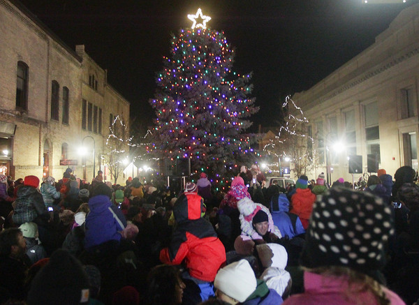 Record-Eagle/Keith King<br /> The Community Tree Lighting takes place at the intersection of Front Street and Cass Street Friday as part of Downtown's Annual Holiday Open House in Traverse City.