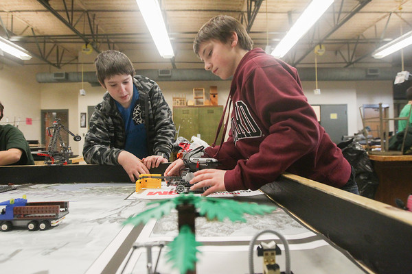 Record-Eagle/Keith King<br /> Michael Riccobono, left, 11, and Spencer Michaels, 11, both on the team, Radioactive Raiders, prepare to test a robot Thursday at Traverse City West Middle School for Saturday's FIRST (For Inspiration and Recognition of Science and Technology) LEGO League qualifying tournament hosted by Grand Traverse Academy.