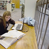 Record-Eagle/Keith King<br /> Alyssa Sanderson, of Charlevoix, works on a paper at the Mark & Helen Osterlin Library on the campus of Northwestern Michigan College.