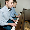 "Record-Eagle/Keith King<br /> Brandon Tyson, left, 12, of Buckley, and his brother, Elliott Tyson, play an arrangement of ""The First Noel"" Tuesday at their home. The piano was a gift from Grand Traverse Pavilions."