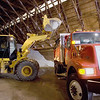 Record-Eagle/Keith King<br /> A mixture of sand and salt is loaded into a truck at the Grand Traverse County Road Commmission salt storage facility on LaFranier Road.