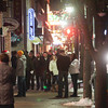 Record-Eagle/Keith King<br /> Shoppers travel along Front Street Thursday during Men's Night in downtown Traverse City.