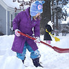 Record-Eagle/Nathan Payne<br /> Lucy Desmond, 7, shovels mounds of snow onto a fort while her sisters Molly, 5, and McLean, 10, work in the background. The trio enjoyed most of the first snowday of the school year outside Monday.