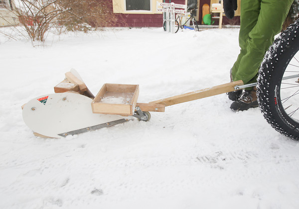 Record-Eagle/Keith King<br /> A snow plow that attaches to a bicycle.