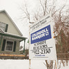 Record-Eagle/Keith King<br /> A Coldwell Banker real estate sign stands in front of a house Tuesday in Traverse City.