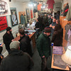 Record-Eagle/Keith King<br /> People gather at Roth Shirt Company Thursday during Men's Night in downtown Traverse City.