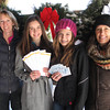 Record-Eagle/Michael Walton Groleau's Farm Market co-owner Lynn Groleau (left), East Middle School National Junior Honor Society members Marais Southby and Madeline Prall , and NJHS advisor Judy Childs stand in front of holiday wreaths sold by East M