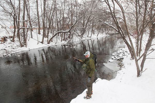 Record-Eagle/Keith King<br /> Andre Martin, of Traverse City, uses a center-pin reel to float fish Thursday for steelhead and brown trout on the Boardman River. Martin practices catch and release and caught a brown trout earlier in the day.