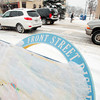 Record-Eagle/Keith King<br /> Snow accumulates Friday along Front Street in downtown Traverse City.