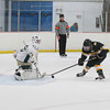 Record-Eagle/Keith King<br /> Traverse City West goalie Tyler Buchanan (38) stops a second-period penalty shot by Midland Dow's Steven Roberts (8) Saturday at Howe Arena in Traverse City.