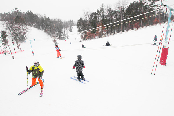 Record-Eagle/Keith King<br /> Skiers and snowboarders gather near the bunny slope Saturday at Mt. Holiday ski and recreation area in Traverse City.