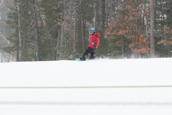 Record-Eagle/Keith King<br /> Carter Blodgett, 8, of Traverse City, snowboards Saturday at Mt. Holiday ski and recreation area in Traverse City.