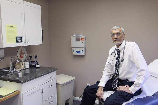 Record-Eagle/Jan-Michael Stump<br /> About a quarter of the patients Dr. Richard Nielsen and his partners at Crystal Lake Clinic see at their 8 clinics in the region, including this one on East Eighth Street in Traverse City, are on Medicare or Medicaid.