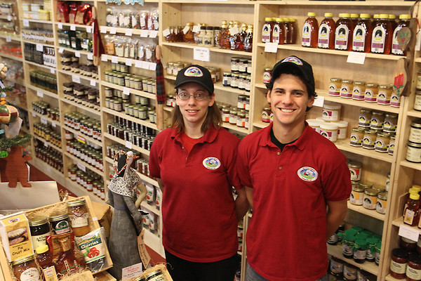 Record-Eagle/Jan-Michael Stump<br /> Mi Farm Market co-owners Satin Sutherland and Scotty Bruce stand in the store, which features goods from about 50 producers from around the state of Michigan.