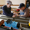 Record-Eagle/Keith King<br /> Rick Ghering, left, of Traverse City, and Dave Knapp, right, of Kingsley, size sections of track Tuesday, December 11, 2012 as they set up for the upcoming Festival of Trains at the History Center of Traverse City scheduled for December 15 through January 1. Knapp is a member of the Northern Michigan RailRoad Club.