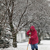 Record-Eagle/Jan-Michael Stump<br /> Deb Mikko shovels the driveway of her home on Panorama Lane in Garfield Township during Thursday's winter storm.