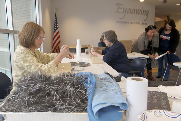Record-Eagle/Jan-Michael Stump<br /> From left, Carol Ritter of Interlochen, Brenda Reynard of Leland, instructor Nodwesi Red Bear and ebecca Woods of Traverse City work on plaiting porcupine quills Saturday at the Eyaawing Museum and Cultural Center in Peshawbestown. The technique, used primarily by Plains, Eastern Woodlands and Great Lakes tribes, is used for items ranging from necklaces and moccasins to knife sheaths and headdresses.